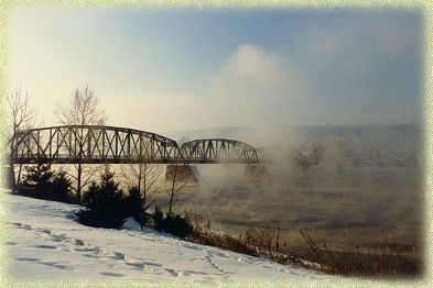 Steam rising from the river on a cold winter day.